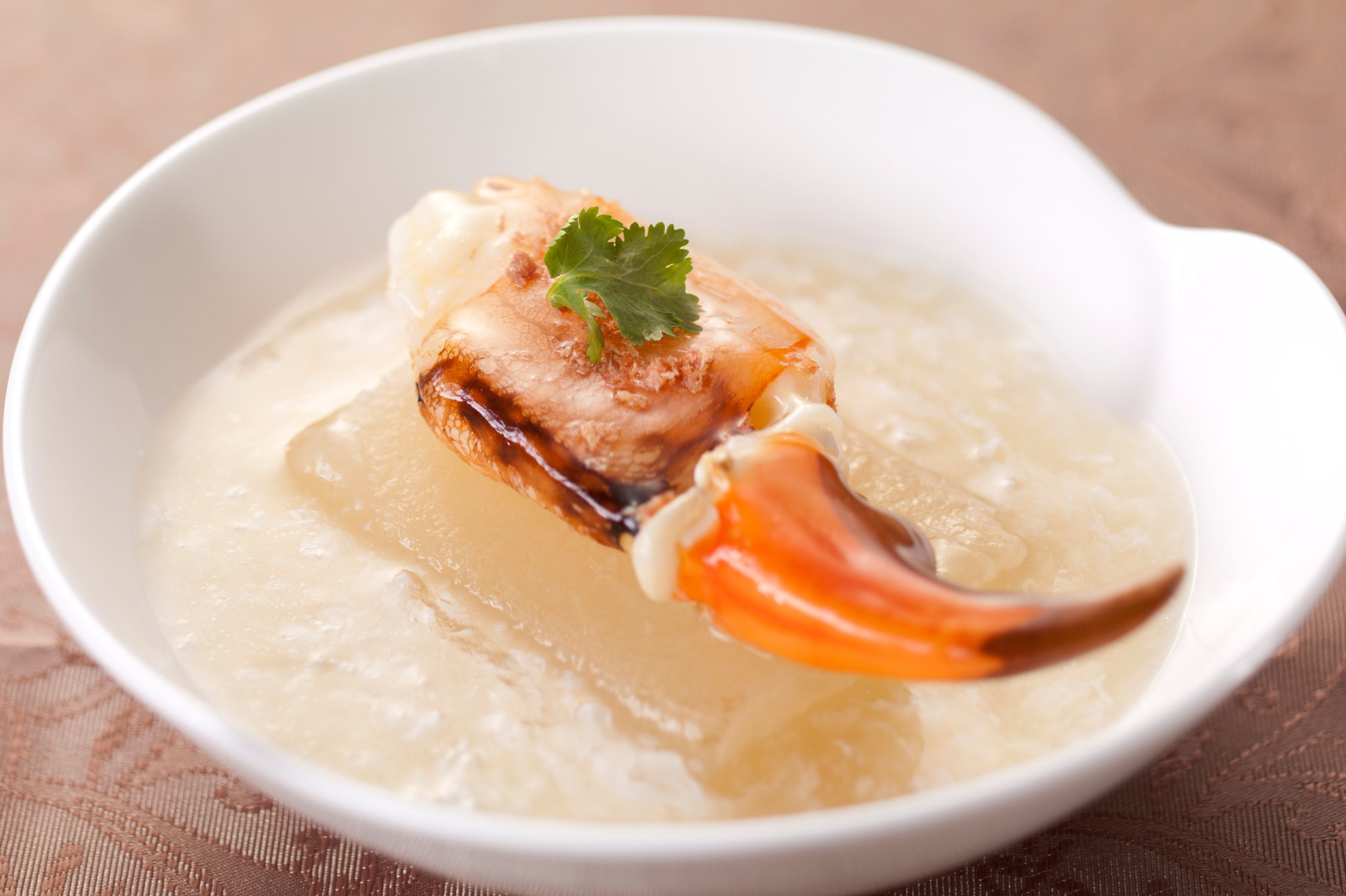 Steamed fresh crab claw with winter melon in egg white